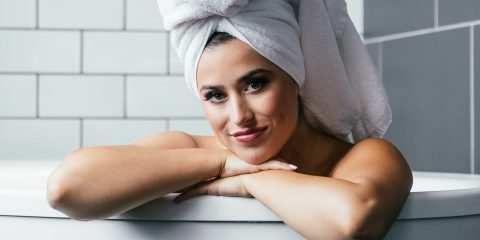 women with hair towel on her head. women smiling