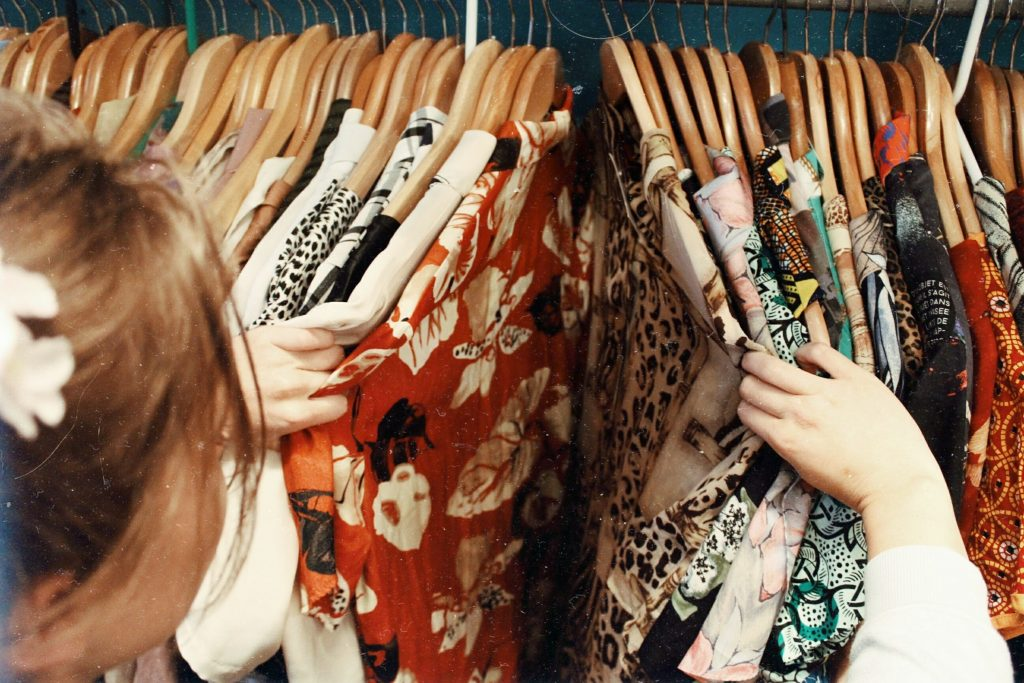 A women looking at clothes on a clothes rack