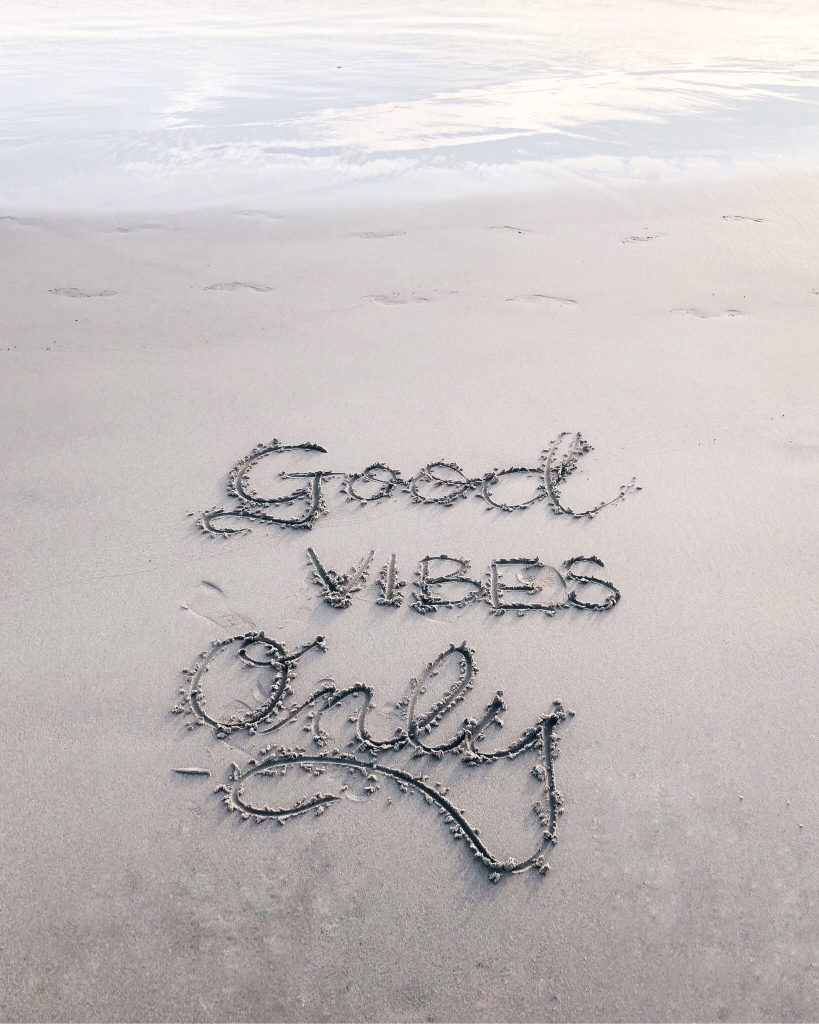 Good vibes only message on the beach