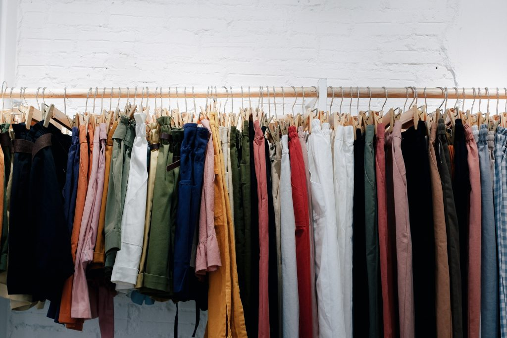 Clothing rack with loads of clothes on it