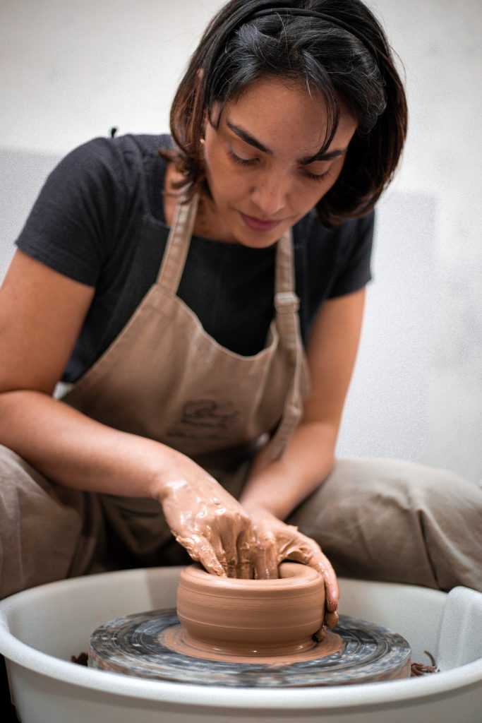 woman doing pottery