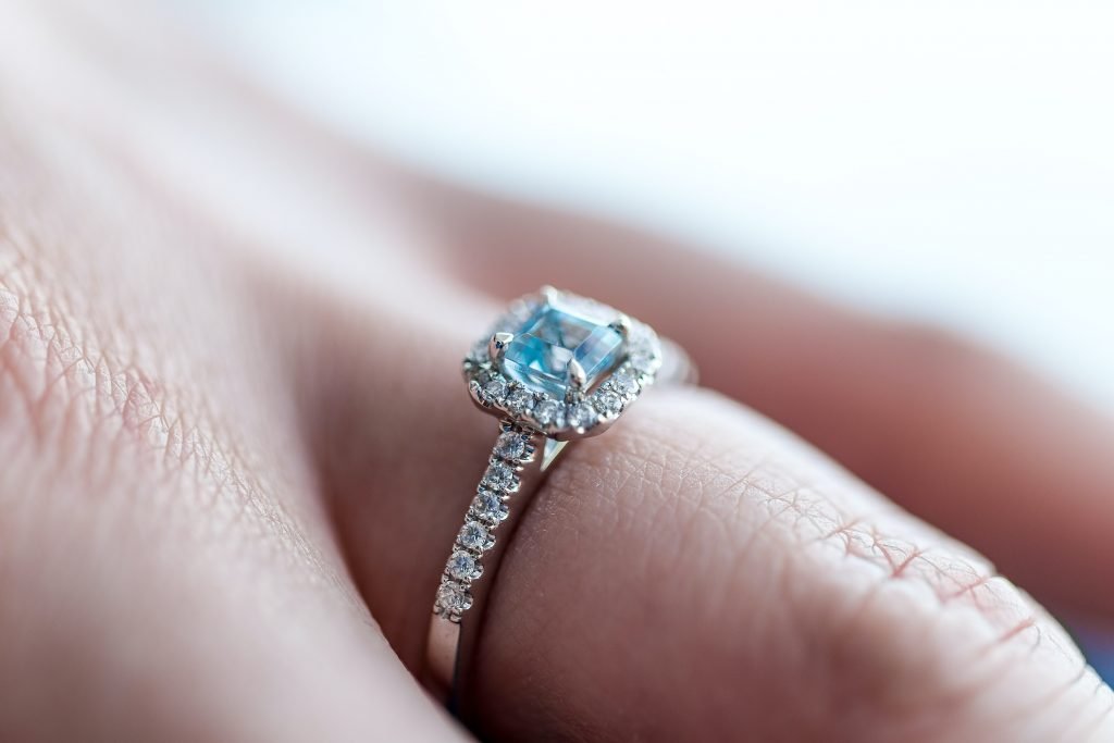 engagement ring on a womans finger