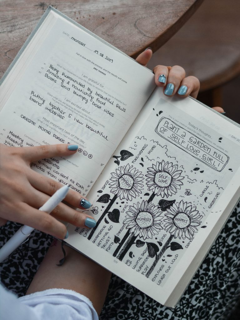 woman reading her journal which has positive information in it