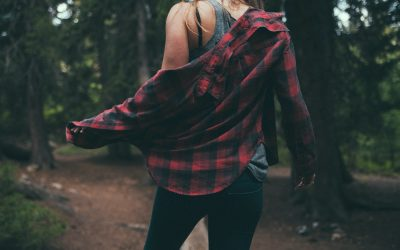 woman wearing flannel shirt with black jeans