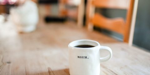 a coffee cup with the word begin on it