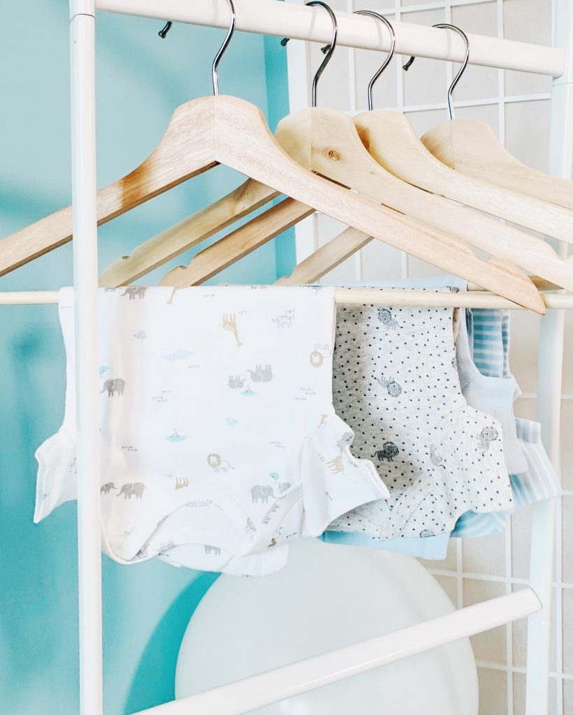 baby clothes hanging on a clothing rack