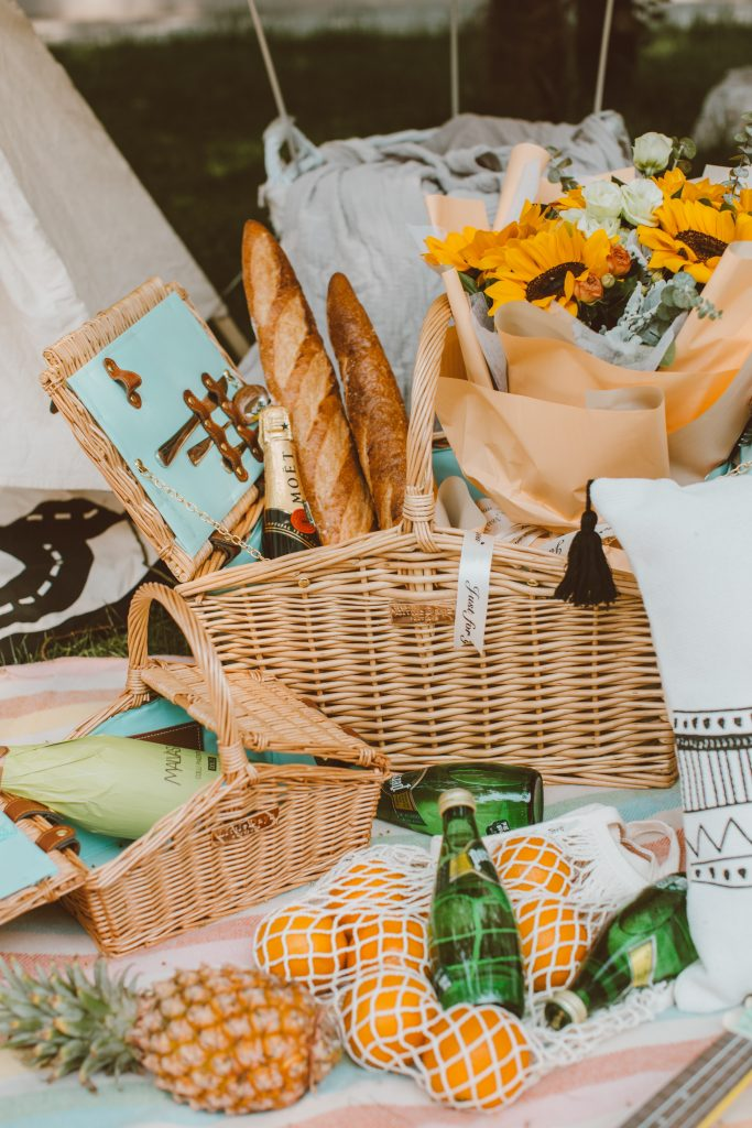 picnic-basket-with-wine-cheese-flowers-in-it