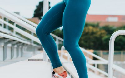 woman wearing tight blue leggings and crop top activewear